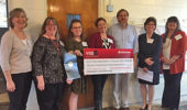 Ohio Museum of Discovery board members with notice of their grant from the State Farm Youth Advisory Board.