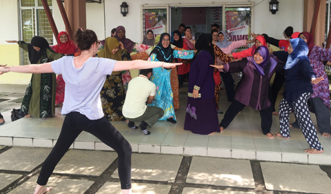 Students leads an interactive yoga class at an adult day center near Kuala Lumpur on the Malaysia program.