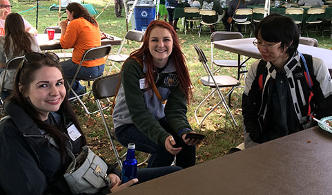 "Haley Hemming, Jacklyn Hockenberry, and Yixin ""Vito"" Yang at the Department of Sociology and Anthropology Tailgate Event during 2016 Homecoming"