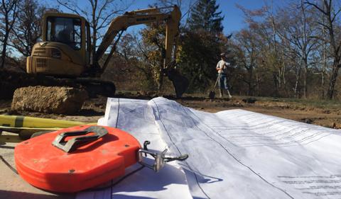 Blueprints at construction site