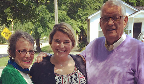 Jeanne Sloan '__, Alison Grossman '14, and Jerry Sloan '59 on a residential street in partial shade