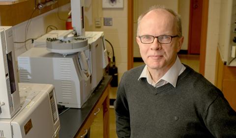 Dr. Klaus Himmeldirk, posing in a lab.