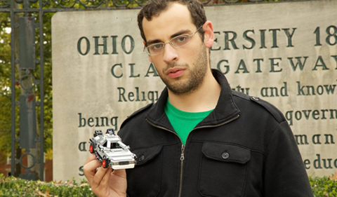 Abdalah El-Barrad holding a model car