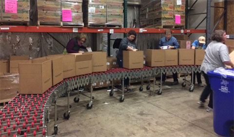 Assembly line packing at SE Ohio Food Bank
