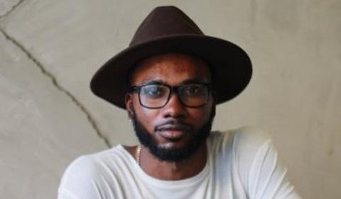 Ayomide Awojinrin, wearing a hat