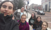 Visiting Greek scholar Efi Athanasopoulou (left) with OHIO students Jericha Tumblin, Shannon McLaughlin, Kelly Bilz, Alayna Gould and Micaela Eberhard in front of the Class Gateway on College Green