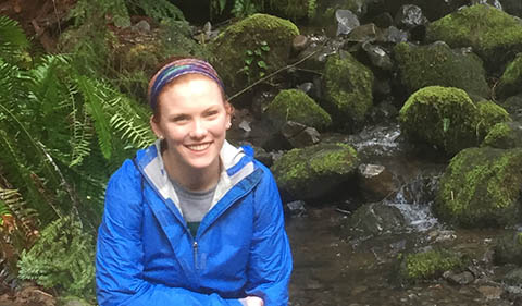 Megan Norris in front of moss covered rocks next to Lower Punch Bowl Falls, Columbia River Gorge, Oregon, in February 2016