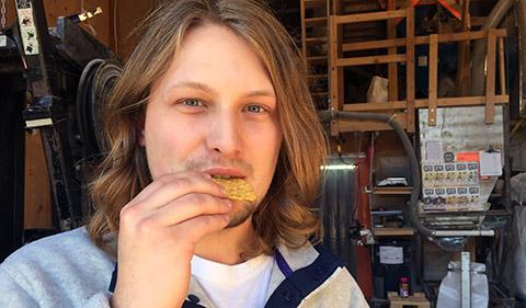 Sam Heckle eating a corn tortilla chip at Shagbark Mill