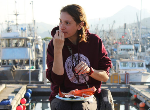 Butts credits the internship with helping her hone her interests and showing her a world outside of Ohio, Shown here eating lobster.
