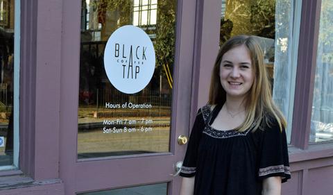Elisa Bergmeier, posing in front of Black Tap storefront