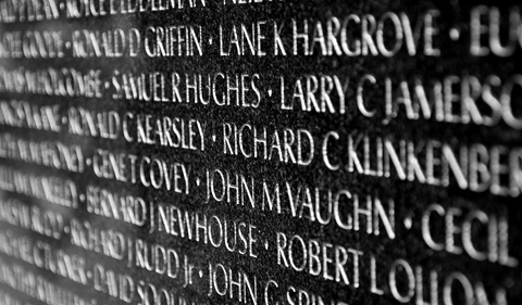 Names of Vietnam war casualties on Vietnam War Veterans Memorial in Washington DC, USA. Names in chronological order, from first casualty in 1959 to last in 1975.