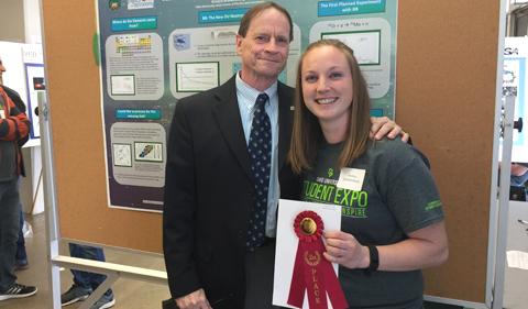 Kristyn Brandenburg with Dr. Descutner