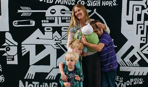 Erica Andrews with three of her children Forest; 12, Vera; 6, Cian; 4, and Silas (now 15 months) outside of Seigfred Hall and the Arthur Eldridge mural, Ohio University, May 2016.