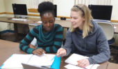 Francisca Lekey (left) and Anna Palmer (right) organize their research for the next phase of their thesis.