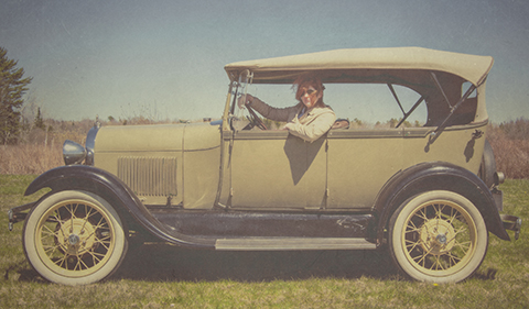 Pardo driving a 1928 Ford Model A Phaeton during the 2016 New England Auto Auction™