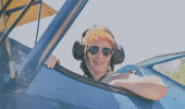 Kathryn Pardo in the front seat of a1941 Stearman at the 2016 Wings & Wheels Spectacular summer air show.