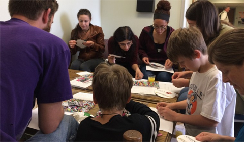 """Open house activity making jewelry using letter beads to create phrases based on translation of codons to amino acids such as """"nice genes."""""""