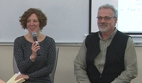 Rachel Terman, with microphone, and John Winnenberg, seated