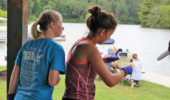 """Students sample water at Strouds Run State Park as part of """"CSI Athens"""" during STEMstart."""