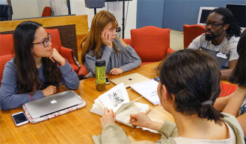 Graduate students in ELIP 5140 participate in weekly group discussions.