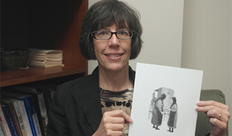 Dr. Katherine Jellison, holdng a drawing
