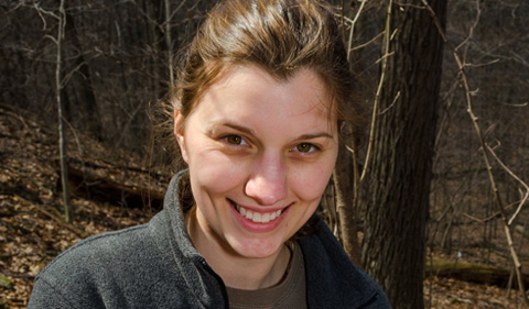 Maggie Hantak, doing fieldwork in the forest.