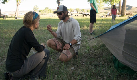 Lexi Smith, left, learns from an instructor how to tie the required knot for pitching a tent. Photo courtesy of: Lexi Smith