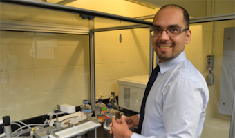 Amir Farnoud in his laboratory in Stocker Center.