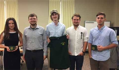 Five Wayne interns stand side by side in classroom