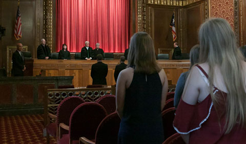 Institute students at the Ohio Supreme Court, standing before justices