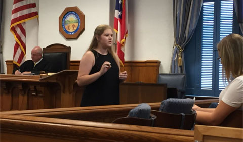 Olivia Mayer presents an opening statement to the jury in the Athens Courthouse.