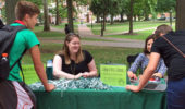 """Advisers Stevi Miller and Tetyana Dovbnya help students at """"Advising on the Green."""""""