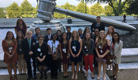 The Summer Law and Trial Institute 2017 Cohort, group photo outside Ohio State Supreme Court, with giant gavel
