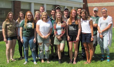 Biology undergraduate peer advisers, standing for a group photo