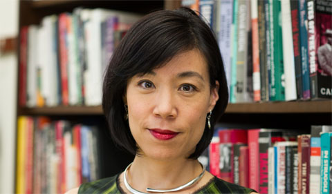 Dr. Naomi Murakawa, standing in front of bookshelf