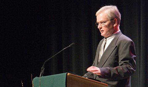 Dr. Steven Miner, standing at lecturn