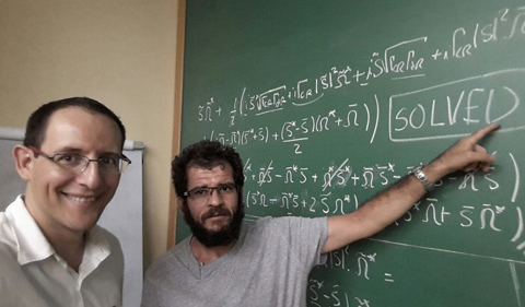 Luis GGV Dias da Silva of University of São Paulo and Edson Vernek of Federal University of Uberlandia are pleased after solving a particularly difficult mathematics problem which allowed for a compact final form of the transport formula.