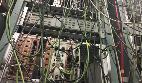 Cabling in the control room allows the signals generated by the subatomic particles produced in collisions to be recorded and analyzed.