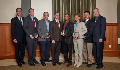 OHIO administrators celebrate the 2017 Presidential Research Scholars. From left to right: Joseph Shields, vice president for research and creative activity and dean of the Graduate College; Daniel Phillips, professor of physics and astronomy; Steven W. Evans, professor of psychology; David Descutner, interim executive vice president and provost; Avinash K. Kodi, professor of electrical engineering and computer science; Julie S. Owens, professor of psychology; Hao Chen, professor of chemistry and biochemistry; M. Duane Nellis, president. Photo credit: Evan Leonard/Ohio University.