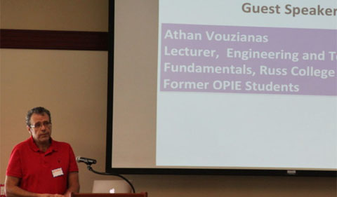 Athan Vouzianas, Lecturer of Engineering and Technology Fundamentals at Russ College and OPIE alum, shown with powerpoint presentation
