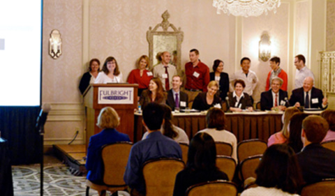 Augustine, pictured seated right of the podium, has worked to help manage the Fulbright Programs in China, Taiwan, and Hong Kong, to name a few.