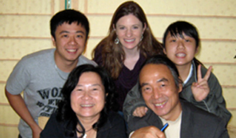 Victoria Augustine, top center, poses with the Lai Family, who played a pivotal role in influencing her career path.