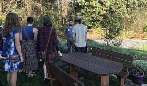 Students listen to a talk at Eden Hall Farm