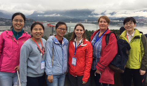 Stigall with a group of early career women at the Three Gorges Dam