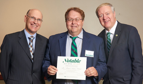 From left, Dean Robert Frank, Dr. Michael Kukral, and President M. Duane Nellis at the 2017 Notable Alumni dinner.