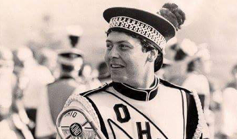 Michael Kukral in the Marching 110, shown here looking over his shoulder.