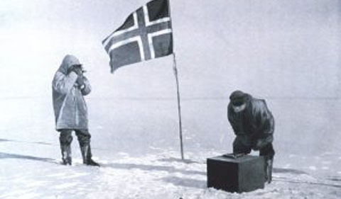 "This photo, ""Taking an observation at the pole,"" shows the Norwegian team taking measurements at the South Pole. It appeared in Roald Amundsen's book, ""The South Pole."" Credit: Roald Amundsen; public domain."