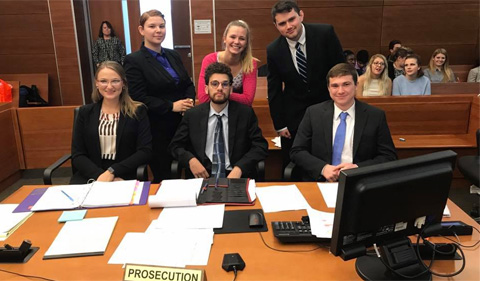 Prosecution team members seated L-R Taryn Osborne, Noah Allen, Elliott Smith, standing L-R Hazel Minich, Katie Belle Neuman, and Austen Burns