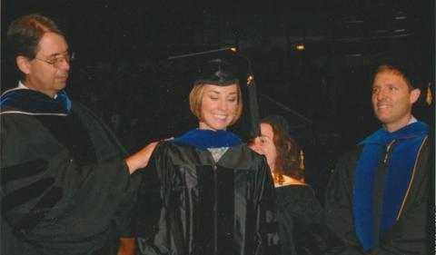 Rachael Peckham gets her doctoral hood at graduation.