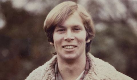 Richard Clayton in his college days, wearing coat